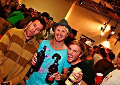 L to R: Stephan Garcia of skatewarehouse.com and Ambission owners Dustin Odbert and Dylan Odbert at Ambissionäó»s äóìHot dogs and Champagneäó  art show.