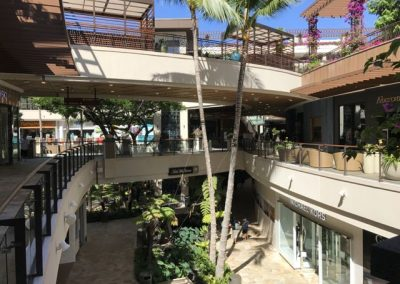Inside the winding space at the shopping center. See that tiny sign with directions to Saks? Saks is at the very end of center with no visibility from the main Waikiki shopping street.