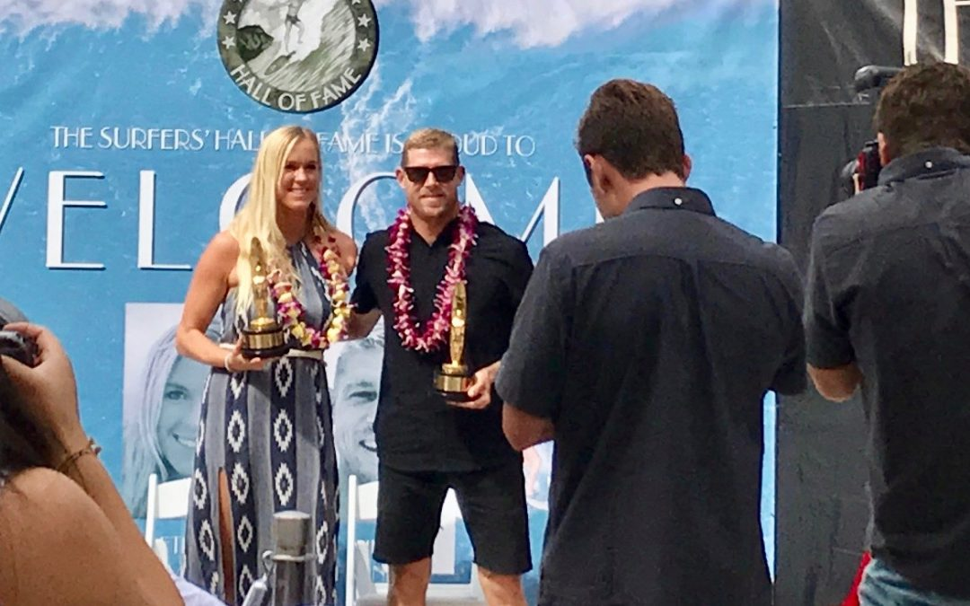 Bethany Hamilton and Mick Fanning pose for photos after receiving their awards