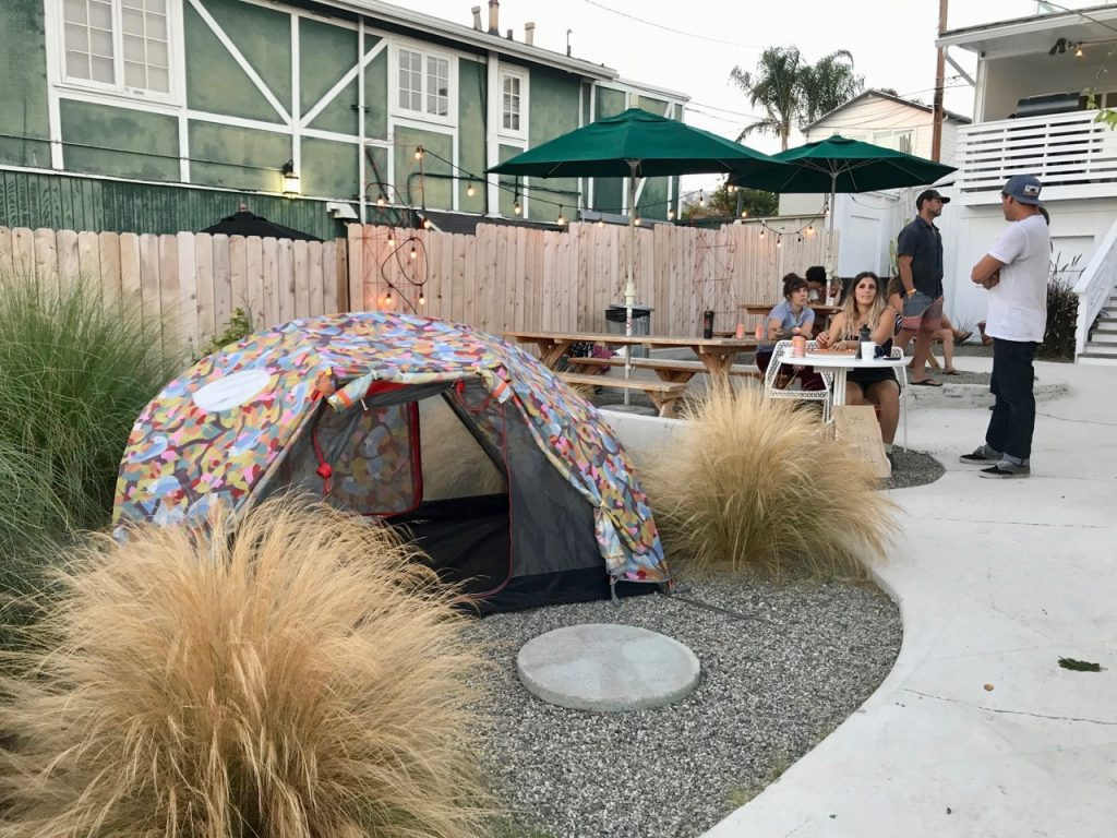 Poler set up one of its tents at the entrance to the store. Shop-eat-surf photos.