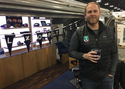 Zeal Optics President Ben Peters with the traveling Airstream display at the 2017 Snow Show in Denver. Shop-eat-surf file photo.