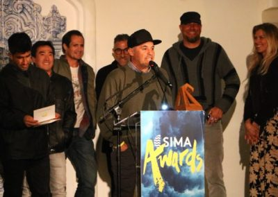 Chuy Reyna accepting the Slater Designs Performance Shortboard of the Year - Photo by SES