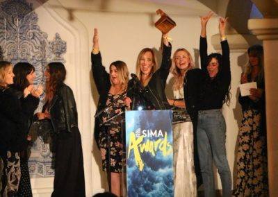 An estatic Billabong Women's team with the Women's Apparel award - Photo by SES