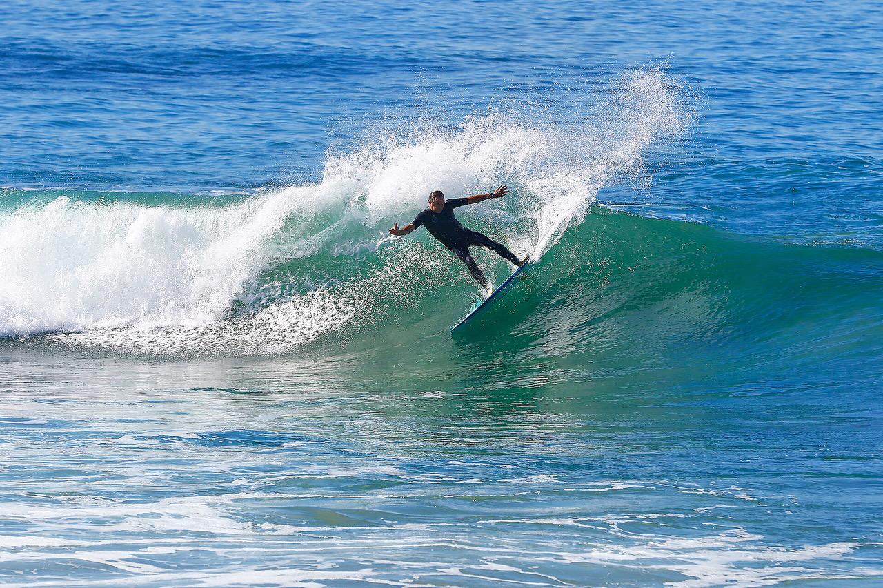 PaulNaude surfing