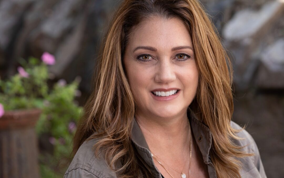 Monica Mirro green jacket Headshot